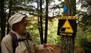 hiker surprised by caution sign